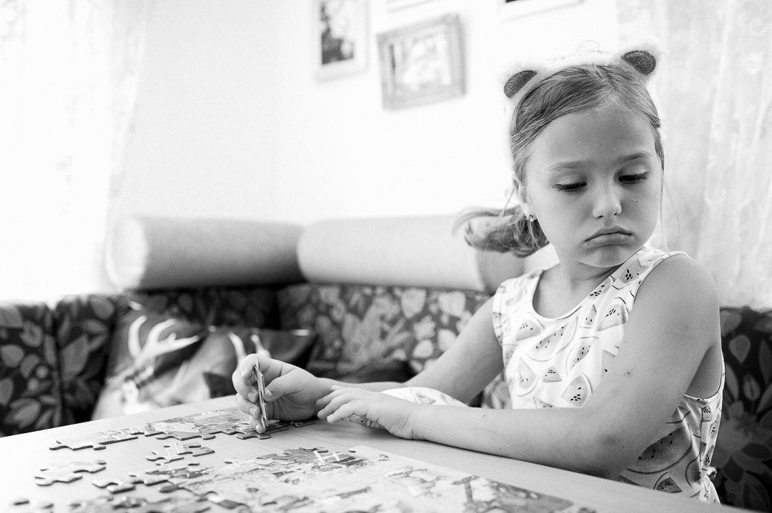 girl frustrated with a puzzle