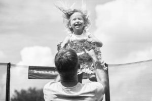 father and daughter on a trampoline