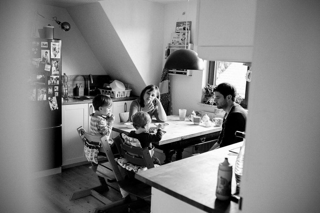 family of four eating fruit