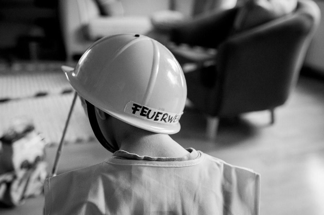 boy with firebrigade helmet