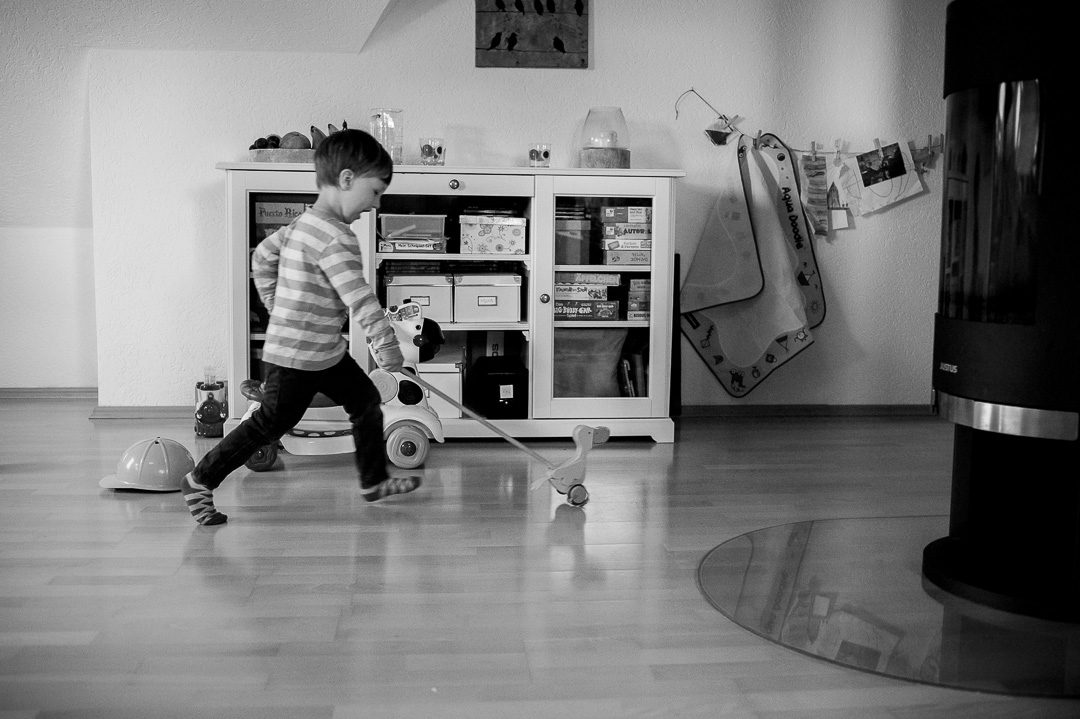boy and wooden duck running
