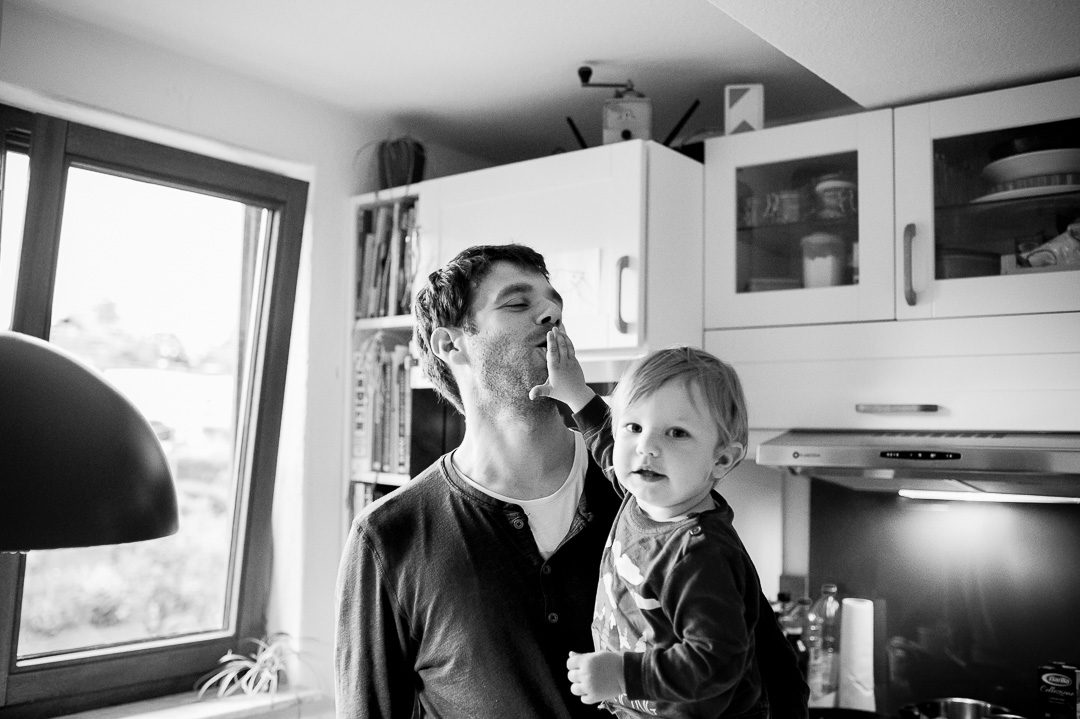 boy feeding carrot to father