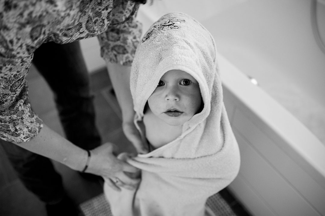 boy with towel over his head after a bath