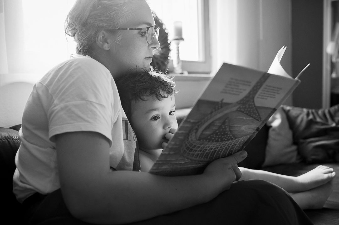 mother reading a story to son