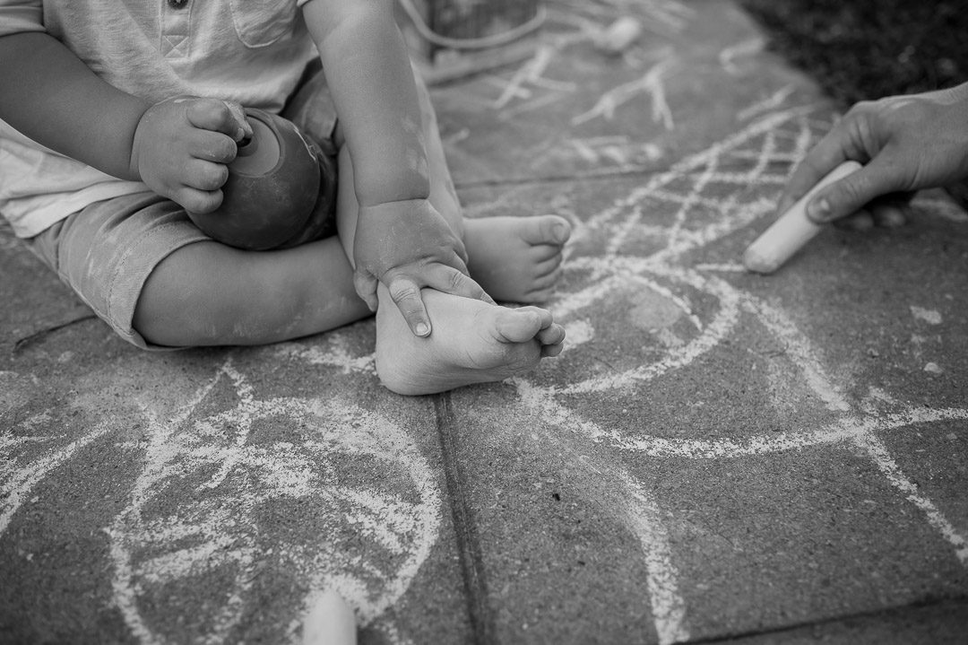 mother and son drawing with chalk