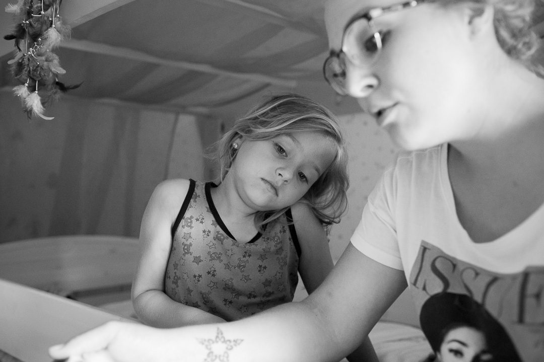 daughter listens to mother telling a story