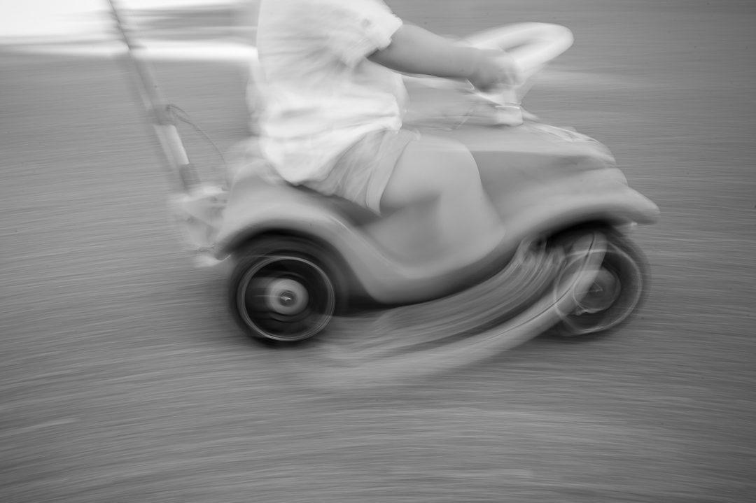 boy racing on bobbycar