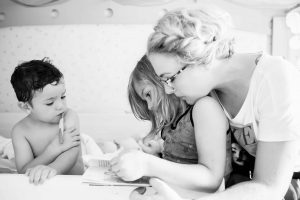 mother reading bedtime story to children
