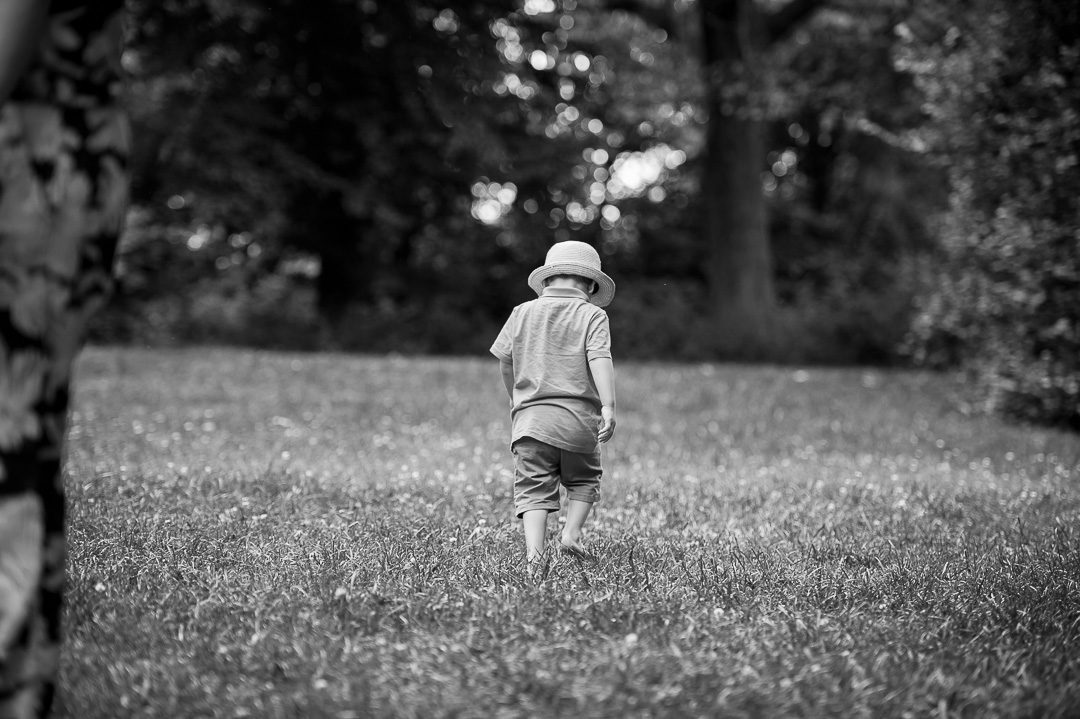 sulking boy walking away from Dad