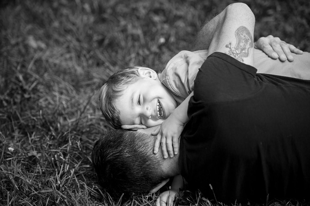 Dad and son hugging and laughing