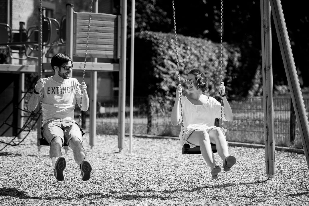 parents on a swing at children playground