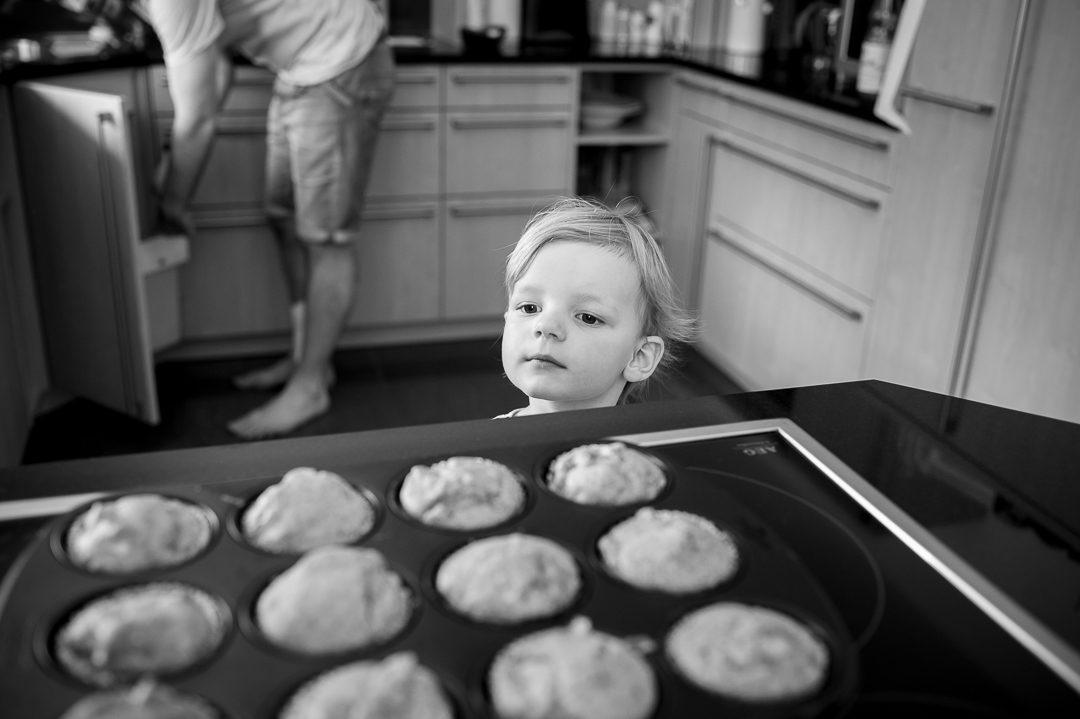 girl eyeing freshly baked muffins