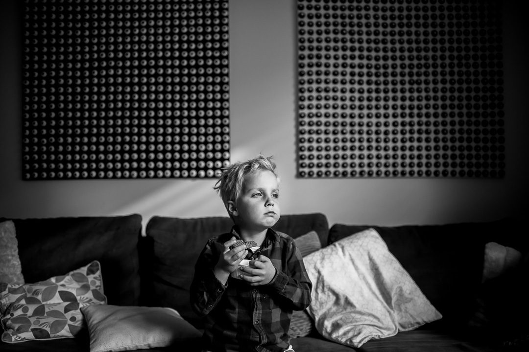 boy eating a cookie in stylish home Augsburg