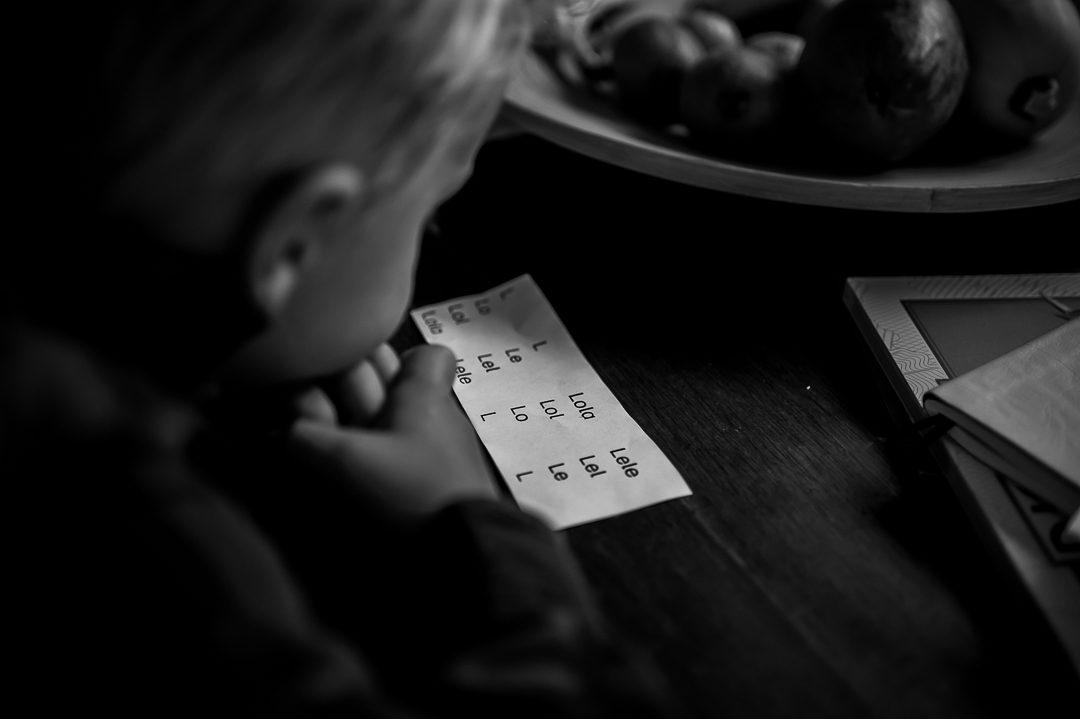 boy doing his homework on kitchen table