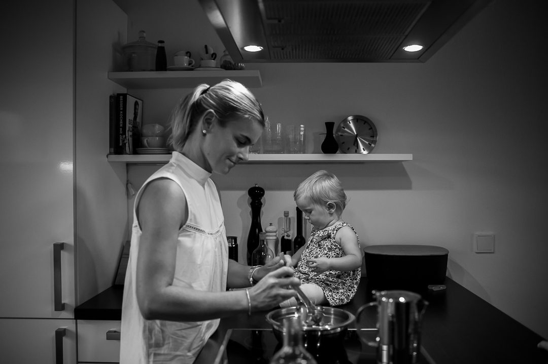 child helps mother prepare dinner