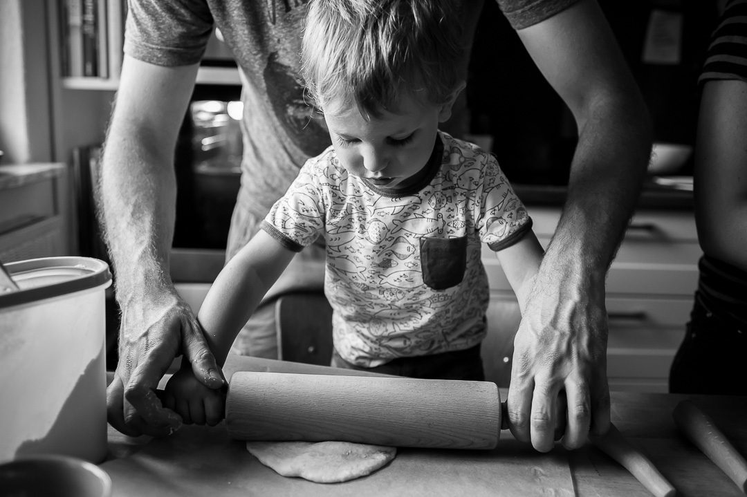father and son baking pizza