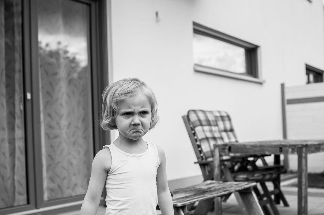 little girl with angry face