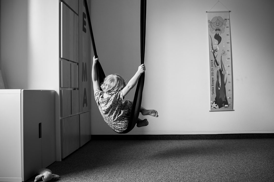 girl on indoor swing