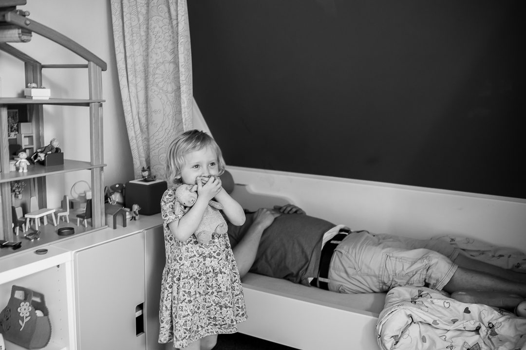 girl giggles while Dad is lying in her bed